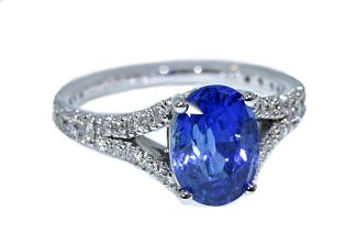 Blue sapphire oval split shank pave diamond ring